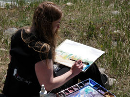Kendra painting as part of the Artist in Residence program at Mountain Galleries in Jasper, Alberta