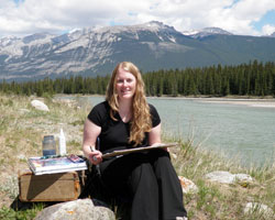 Kendra painting in Jasper beside the Athabasca River during her week as Artist in Residence with Mountain Galleries